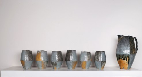 "2015, Soda Fired Porcelain, Kaolin Slip and Glaze, Cone 10, Pitcher: 11"" x 6"" x 5"" Yunomis: 5.5"" x 3"" x 3"""