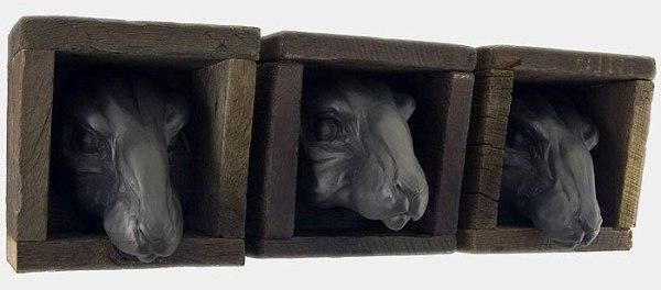 """The Voyeurs, 8""""h x 7.5""""w x 7.5""""d, 2006, black porcelain, wooden boxes"""