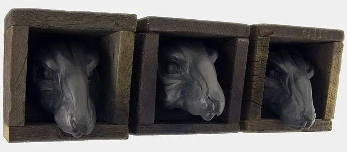 "The Voyeurs, 8""h x 7.5""w x 7.5""d, 2006, black porcelain, wooden boxes"