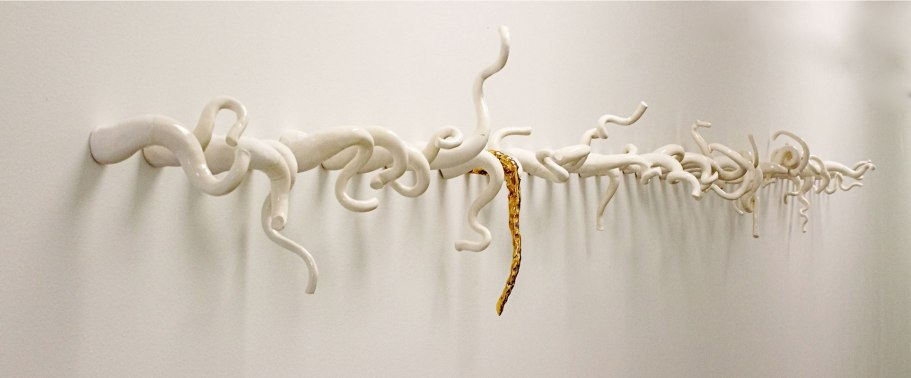 Porcelain with gold luster and mid-range glaze, 16 x 2 x 3/4 feet