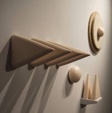 "porcelain, slipcast. Cone 04 oxidation. Industrial floor scrubber pads, wooden shelf. 42"" x 65"" x 11"", 2011"