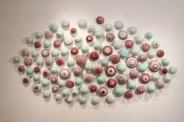 """wall sculpture, porcelain and glaze, 2008, 60"""" H x 110"""" x 6"""""""