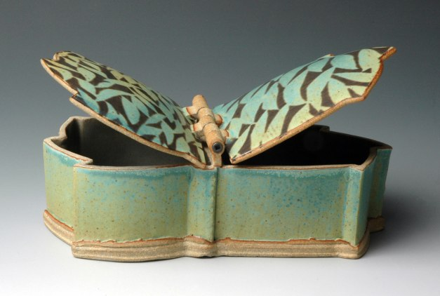 Double-Lidded Box, hand-built with extrusions and slabs, stoneware with stenciled black slip and copper matt glaze, cone 10 reduction, 8 inches across, 2013