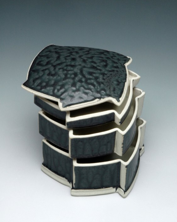 Three-Tier Stacking Box, hand-built with extrusions and slabs, white stoneware with ash glaze, cone 10 reduction, 7 inches tall, 2011