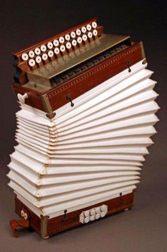 "Death of an Accordion, Porcelain, Wood, Brass, H23""x W16"""