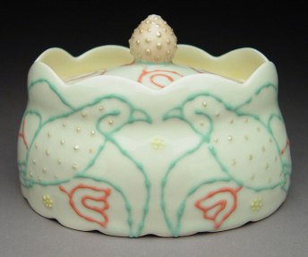 "Wheel-thrown and altered porcelain, colored slips and glaze, cone 6 - 7""x5.5""x6"""