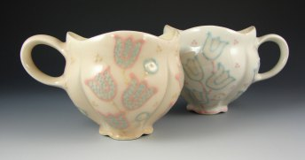 "Wheel-thrown and altered porcelain, colored slips and glaze, cone 6 - 4.5""x5.5""x4"" each"