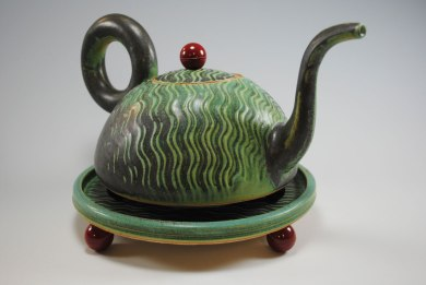 """slab built with press molded and wheel, thrown parts, industrial fittings and parts, stoneware c/9 reduction fired, 9""""h x 8""""dia"""