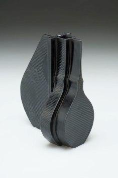 "2015. Slip cast porcelain using modular mold system, appliqué, overglaze decals, 10"" x 7"" x 14″"