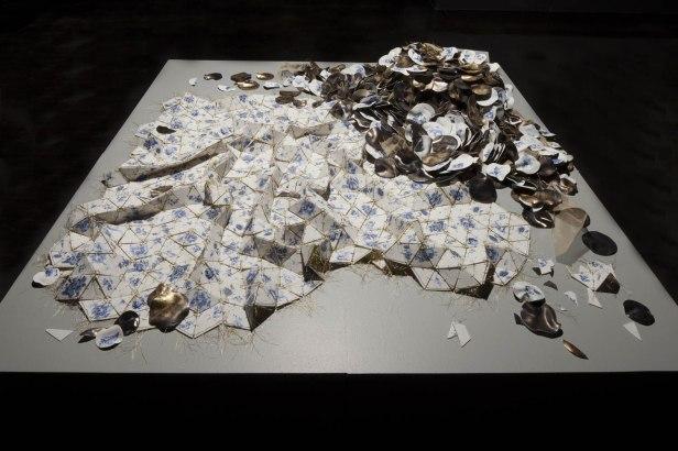 "Porcelain, glaze, decals, gold luster, gold metallic thread, Installed—60"" L x 60"" W x 18"" H (152cm x 152cm x 46cm), 2011"