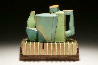 """2015, 10""""h x 11""""w x 13""""d, Hand built cone 3 red clay, terra sigillata, underglaze, and glaze. Electric fired. Laser cut and assembled oak plywood, oil paint."""