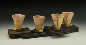 """2014, 7""""h x 21""""w x 9""""d, Hand built cone 3 red clay, terra sigillata, and glaze. Electric fired. Laser cut and assembled Masonite."""