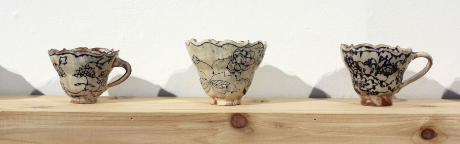 "cup row detail, pinched earthenware, mishima, slip, glaze, avg. cups approx.. 3.5""h x 3""w x 3""d, 2015"