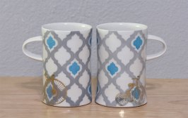 "Wheel-thrown porcelain, underglaze and custom gold decals, cone 7 & 018 oxidation, 4.75x3x4.5"" each"