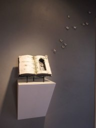 Installation of porcelain butterflies with porcelain book, Porcelain, acrylic rods, steel, Cone 6 Ox, Oxide Wash