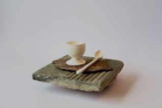concrete tile, metal base, porcelain tea spoon and egg cup. 2015