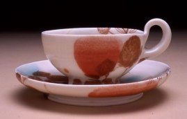 "6""w x 3""h, mid-range porcelain, oxidation, with laser transfers"