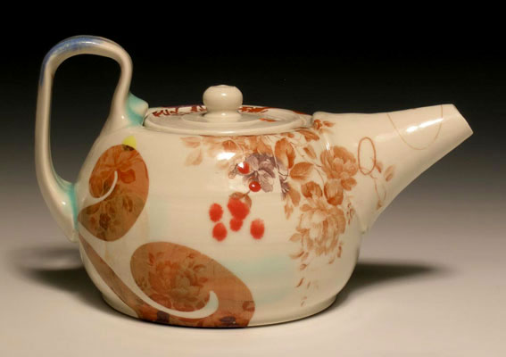 """10""""w x 4""""h x 6""""d, mid-range porcelain, oxidation, with laser transfers"""