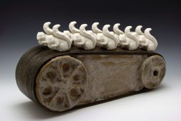 "Factory Work: the belt, hand built stoneware and slip cast porcelain, cone 6 oxidation, 13""Hx28""Wx7""D"