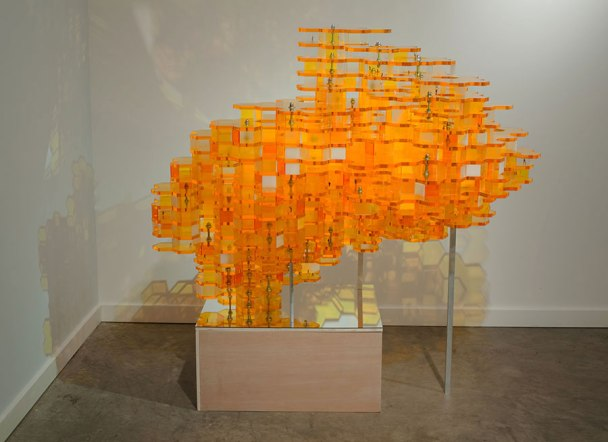"""51"""" x 55"""" x 39"""", Materials: Laser cut acrylic, HO-scale figures, wood/mirror stand and hardware, 2009"""