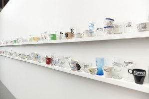 """(installation view), 3'x24'x4"""", commercially produced ceramic and glass ware with screen print decals, 2014"""