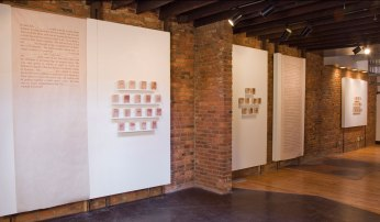 """114 bricks and inkjet print on newsprint, each brick about 4 3/4""""x3 1/2"""" , overall dimensions variable"""