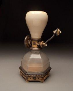 "Wheel thrown and hand built mid-range stoneware, terra sigillata, glaze, fired to Cone 6 oxidation, glass found object, brass acorn nuts, steel. 14"" x 9"" x 7"". 2014"