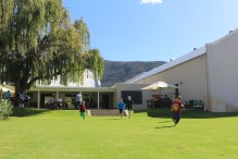 A game of touch rugby is played whilst their parents dine and watch over them. A great family environment.