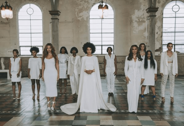 Solange-stands-surrouded-by-friends-and-family