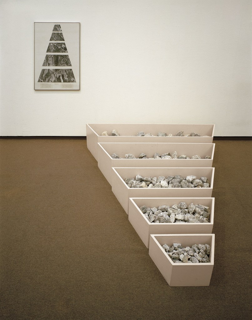 Robert Smithson, A Nonsite (Franklin, New Jersey), 1968, Painted wooden bins, limestone, gelatin-silver prints and typescript on paper with graphite and transfer letters, mounted on mat board Collection Museum of Contemporary Art Chicago, gift of Susan and Lewis Manilow  1979.2a-g Photo: James Isberner, © Museum of Contemporary Art Chicago Image courtesy James Cohan Gallery, New York/Shanghai