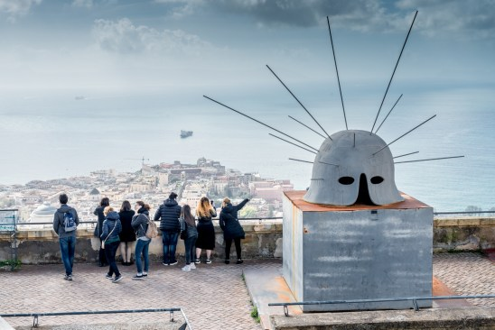 The gulf of Naples from the Vomero's hill, the Helm of the Italian artist Mimmo Paladino on the right, a sculpture recalling the peaceful time (the steel rays) after a long time of war (the archaic helm), as Naples fought for its freedom several times during its history