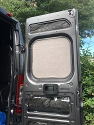 Window cover fitted in door