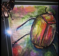 Lisa's scarab beetle and the necklace that inspired it