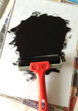Using a brayer to spread the ink