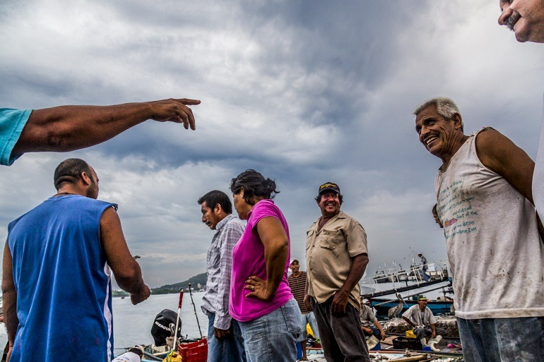 Image: Men Talking. Photographer Matt Mawson captures several men engaged in conversations at the fish market in Mexico