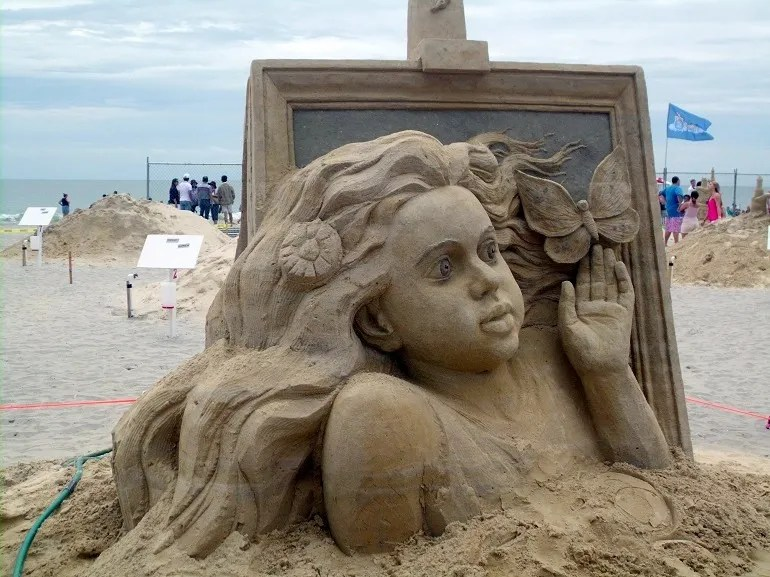 Image-Daydreaming Little Girl by Pavel Mylnikov from Russia captivated spectators ath the World Championship of Sand Sculpting in Atlantic City