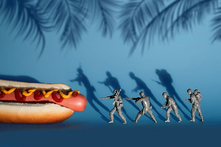 Image-Ready for the attack on the hot dog fortify with ketchup and mustard, soldiers cautiously move in to engage this junk food