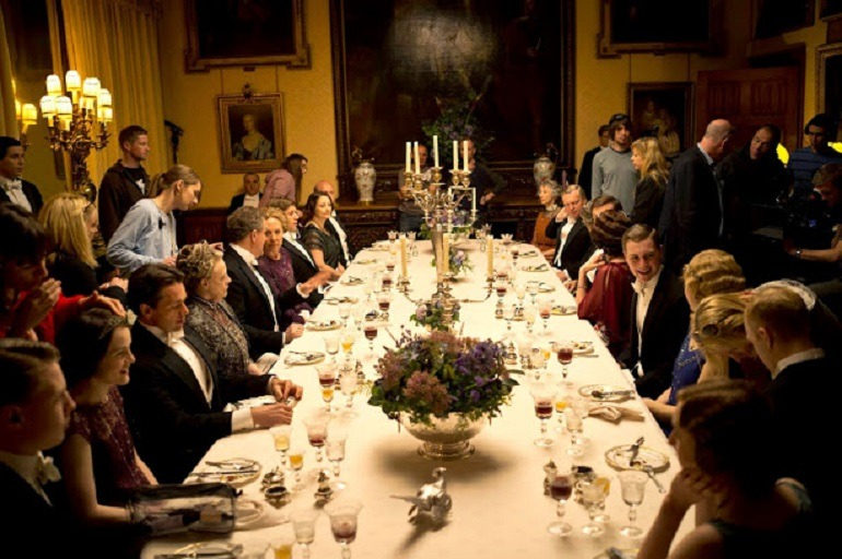 Image of of people Dinning in the high style Highclere Castle, real Downton Abbey which serves as the location for PBS Downton Abbey