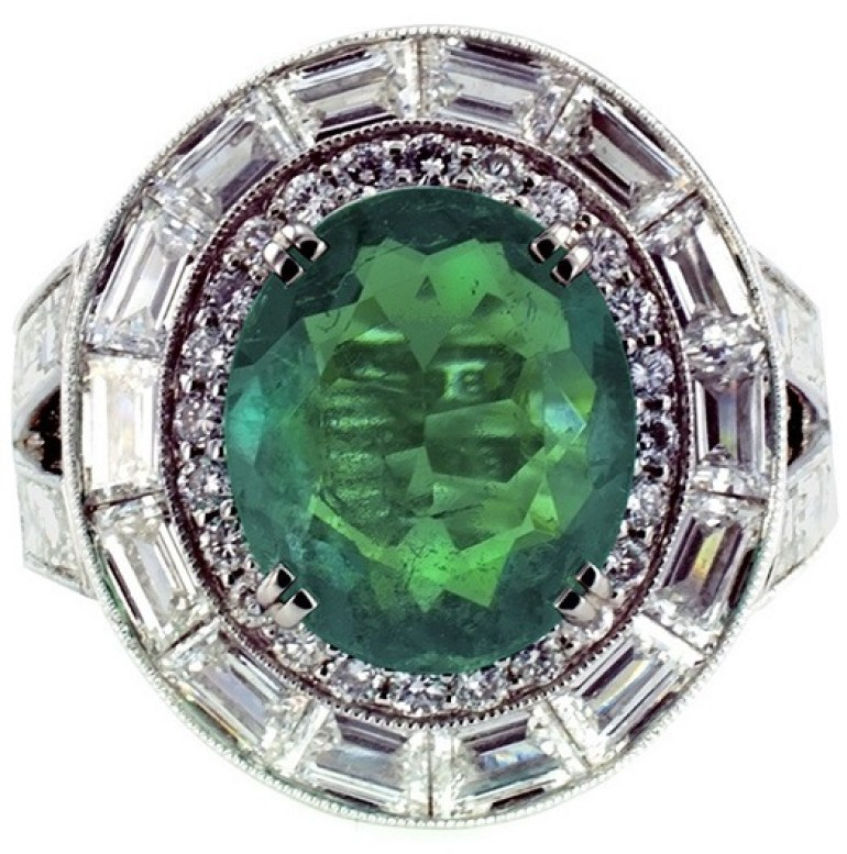 Image: Fabulous Emerald & Diamond Ring: Centering a fine 3.26 carats oval emerald, very clean, with beautiful blue-green overtones, bordered by a row of round brilliant cut diamonds and a row of baguette diamonds, to the split shoulders set with similarly cut diamonds. Antiques Show