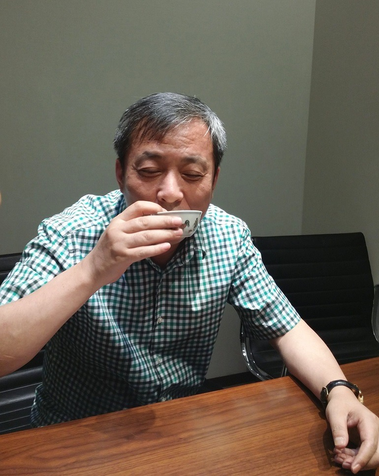 Image- Photography of Mr. Liu Yiqian drinking tea from his prized Chicken Cup bought at Sotheby's for a record art auction price