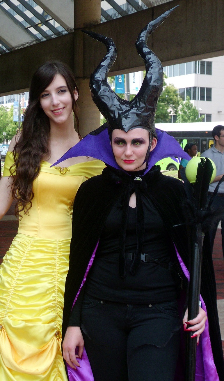 Image of the Maleficent witch and the princess at Otakon Convention , Baltimore Convention Center during outside cosplay.