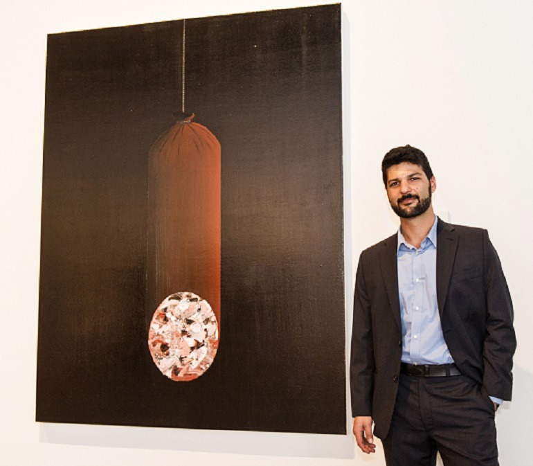 Image: Ufuk Gueray of Winnipeg, Manitoba poses with his work Market that got him honourable mention at the annual RBC Canadian Painting Competition