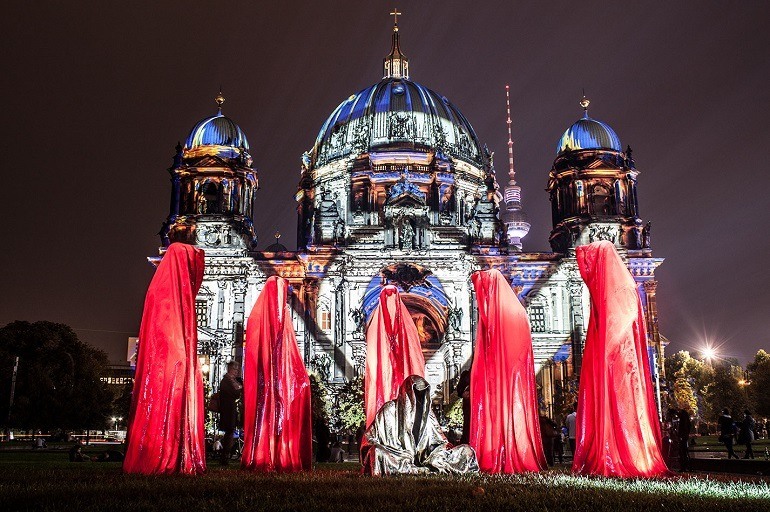 Image: Guardians of Time sculpture during the Festival of Lights at the Old Museum Cathedral Berlin Light Art Show Exhibition- Memory of Berlin Wall