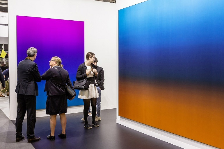 Image: Guests examine paintings and contemporary art at Art Basel in Basel put on display by galleries as the art fair opens -News