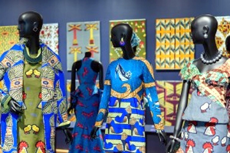 Image: Beautiful dresses made from wax printed fabrics with bold patterns by Vlisco at the Philadelphia Museum of Art is part of African identity