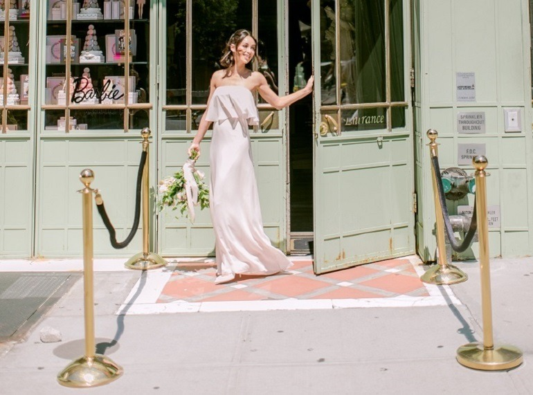 Image: Cara Santana unveiling the 'Cara' dress from the Monique Lhuillier Bridesmaids collection for Vow To Be Chic; Danielle Bernstein and Cara Santana