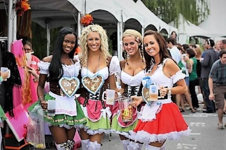 Image: Dressed in German costumes some beautiful ladies enjoy Baltimore Beer Festival during das best oktoberfest