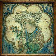 180px-tile_young_man_flowers_louvre_d27813