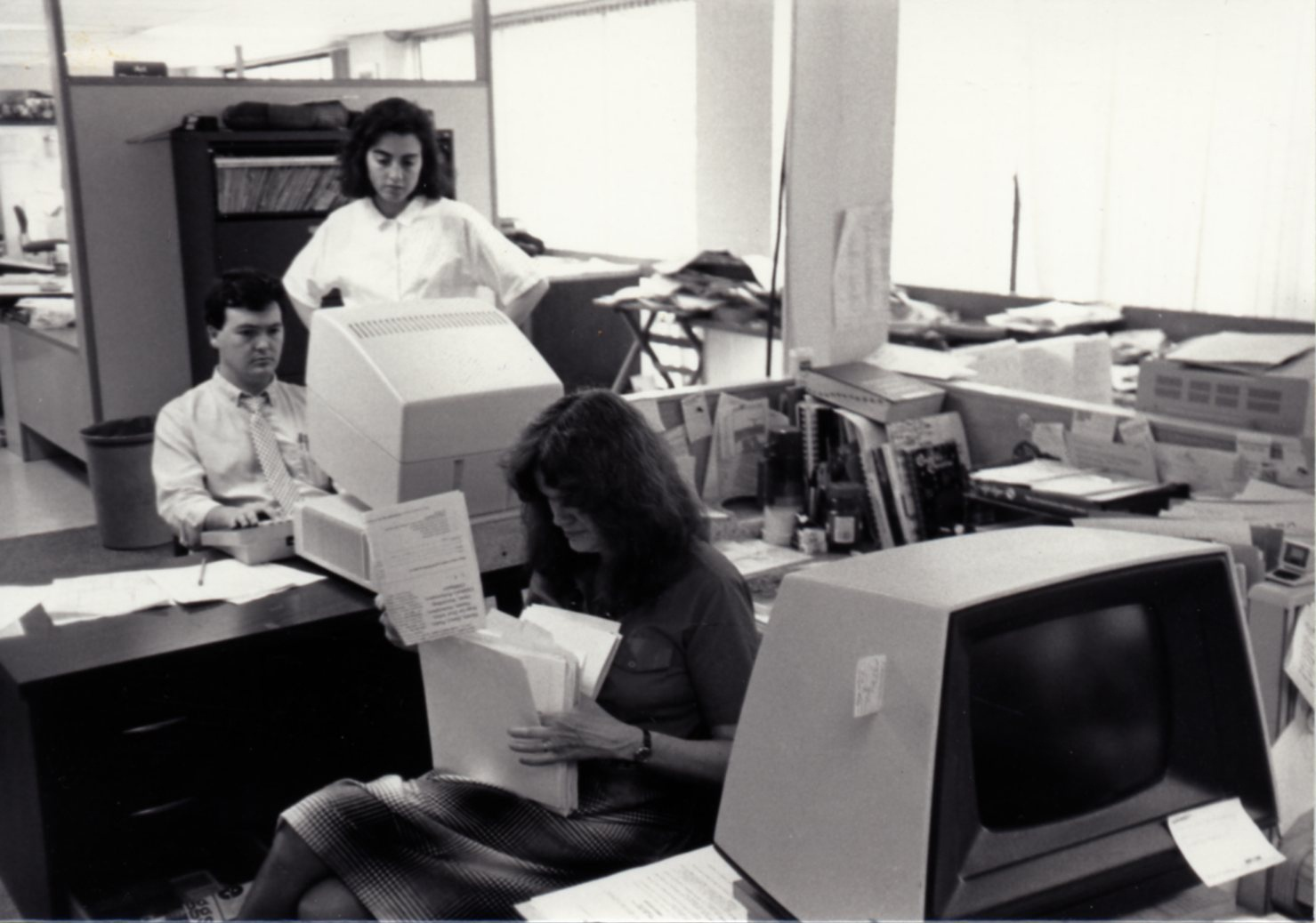 Art Coulson edits a story by Loukia Borrell at The Reston Times newspaper in 1987