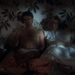 Alice Doesn't Live Here Anymore (1974) | Martin Scorsese production design | Martin Scorsese Films | Ellen Burstyn and man in bed with plant branch tropical wallpaper